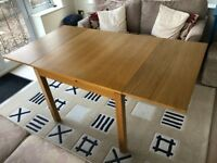 Light Oak Extending Dining Table - good quality veneer and in excellent condition
