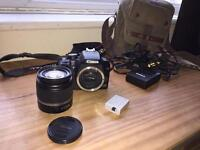 Canon EOS 1000D camera with 18-55mm lense