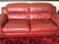 A RED LEATHER 3 PIECE SUITE
