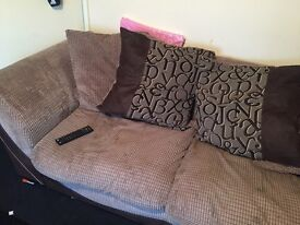 Brown fabric sofa open to offers