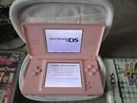 Coral Pink Nintendo DS Lite Bundle with Three DS Games and a charger, Stylus & case