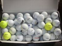 Box full of Titleist golf balls
