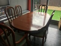 Beautiful old style Dinning table and six matching chairs extending table does not suit new kitchen
