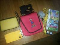NINTENDO DSI XL CONSOLE WITH GAMES VGC CAN POST