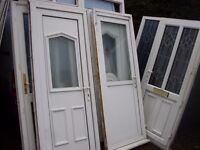 5 upvc doors and 1 handmade pine door all minters