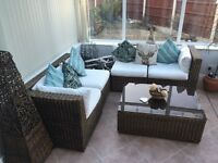 Conservatory wicker furniture with tables and storage under the seats