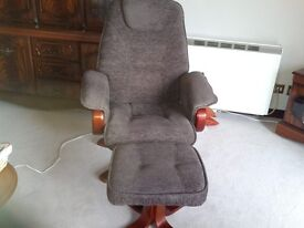Brown relaxer swivel chair and still, brown fabric ,not suede, little use, good condition.