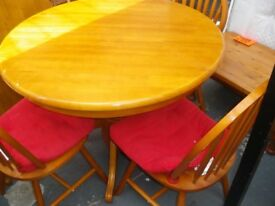 ROUND EXTENDING PINE TABLE AND 4 MATCHING CHAIRS at Haven Housing Trust's charity shop