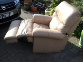 a large/heavy cream armchair which manually reclines in high quality leather