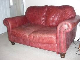 4yr old Red Leather Sofa - Arm is damaged, but otherwise is super comfortable.