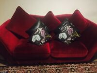 Three seater sofa with cushions used but in good condition