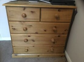 A pine chest of drawers