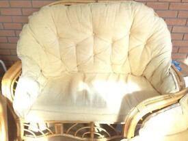 Conservatory suite - two seater sofa and two chairs with gold/cream cushions