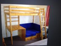 Thuka pine high sleeper with shelves, desk and pull out blue futon.