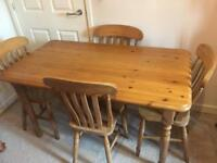 Solid pine table and 4 pine chairs ideal to shabby chic + free local delivery @ £100