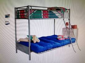 Metal framed bunk bed with double futon
