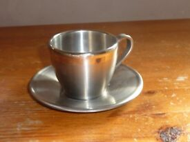 """White metal cup & saucer (possibly stainless steel) plus spare saucer 2"""" high"""