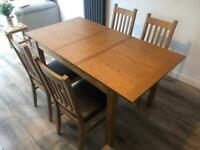 Extendable wood veneer dining table and chairs