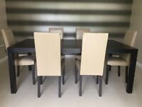 Immaculate dining table and 6 chairs