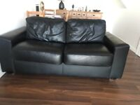 2 black leather sofa beds for sale - very good quality