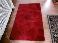 Red color rug