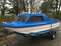 Dory day boat, ready to go on trailer with 20hp Yamaha . Forward cabin, remote steering.