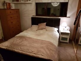 Brown leather double bed. Good condition. Mattress not included.