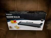 Vacuum sealer. Keep food fresh. Water/air tight.