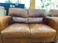 Tan leather sofa and arm chair
