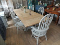 Solid oak extendable dining table and six chairs in shabby chic style