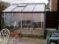 leanto greenhouse. Needs a wall 10ftlong 6foot wide 7,ft high. Aluminion frame.. Glass