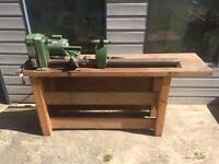 Woodturning lathe on workbench