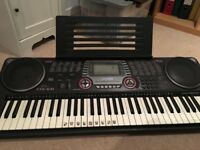 Casio CTK 631 Electronic Keyboard, charger and notes stand, VGC