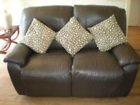 chocolate brown two seater double manuel reclining couch