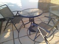 Garden table and folding chairs