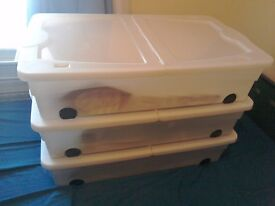 3 plastic under bed storage boxes on wheels
