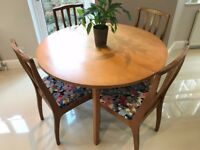 Stunning Round Extendable Dining Table