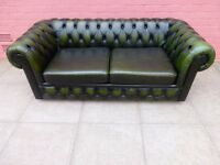 A Large Green Leather Chesterfield Two Seater sofa bed