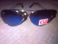 Mens Rayban sunglasses, blue coloured lenses.