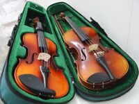 Two 3/4 size Violins