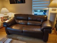 Gorgeous pair of leather sofas and matching ottoman