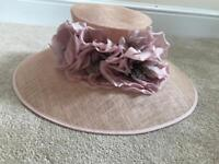 Large pink/purple hat with flower detail