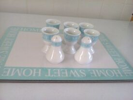 2 large serving mats 6 egg cups salt and pepper pot brand new