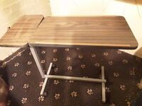 Tilting table to fit over bed.