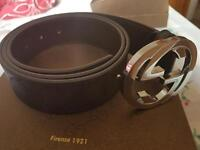 Mens designer belt in box with papers