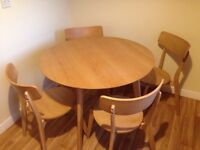 Oak effect round table and 4 chairs. Immaculate condition.