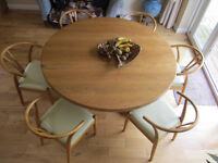 Circular oak dining table (5') and six leather covered wishbone back chairs