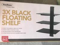 Black floating shelf - unopened