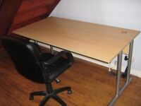 Office desk beech effect - strong and stable - with black vinyl chair.