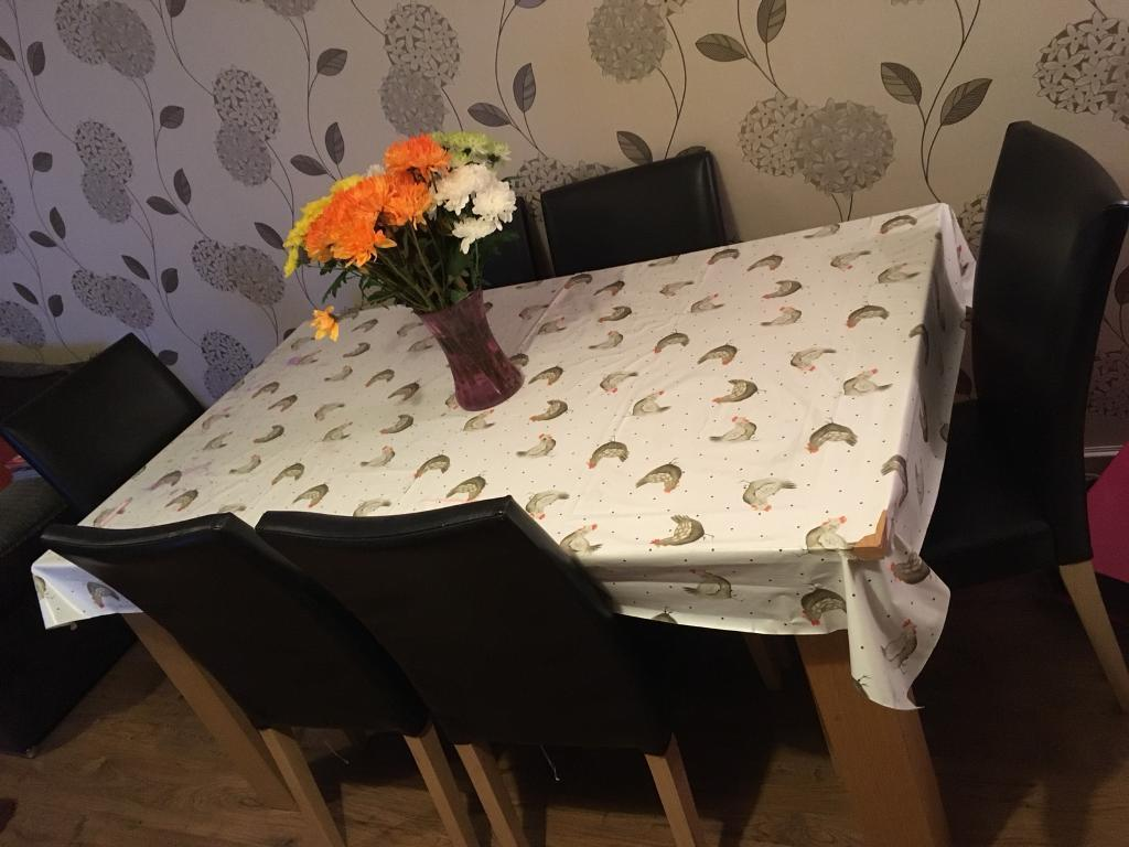 6-8 seater extending dining table and chairs